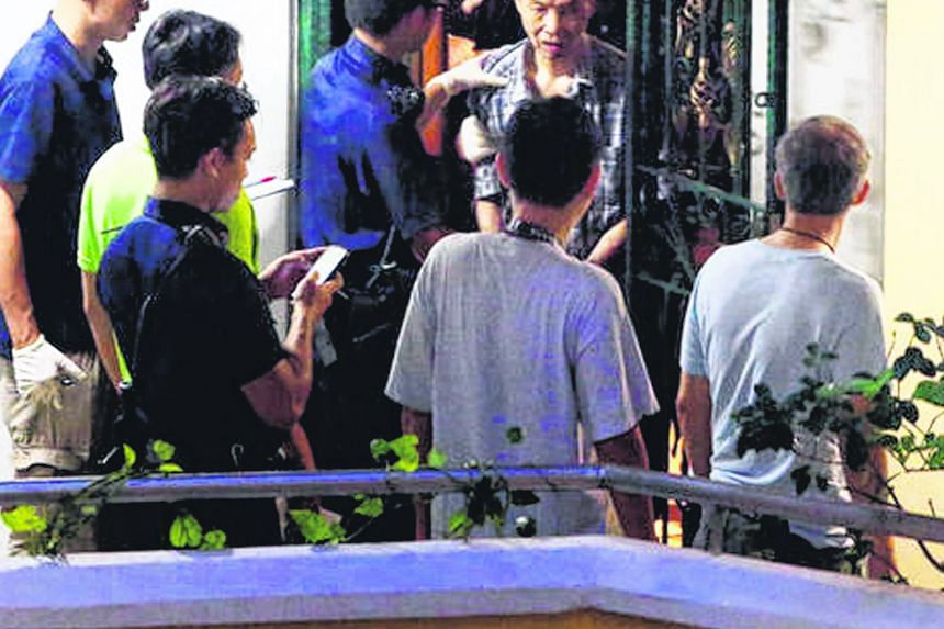 Mr Kong Peng Yee being led away by police officers in March 2016. He has spent the past three months at the IMH as a voluntary patient after serving a two-year jail term for killing his wife of 36 years while having delusions that his family was tryi