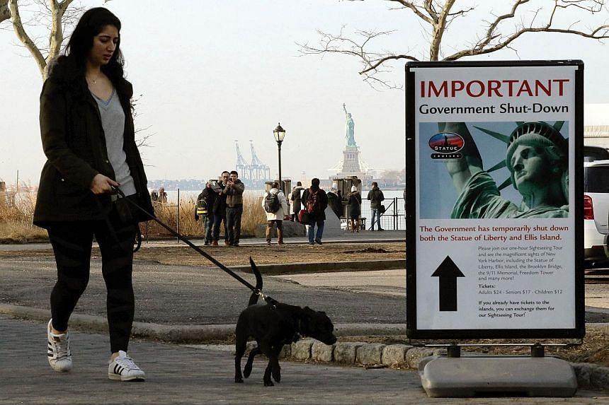 A notice at the Liberty State ferry terminal at New York's Battery Park on Sunday announcing the closure of the Statue of Liberty as part of the US government shutdown.