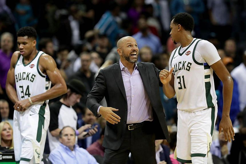 Milwaukee Bucks head coach Jason Kidd (centre) speaking with centre John Henson (#31) during their NBA match against the Charlotte Hornets on Nov 1, 2017. The Bucks fired Kidd on Jan 22, 2018, after he spent three-and-a-half seasons at the helm.