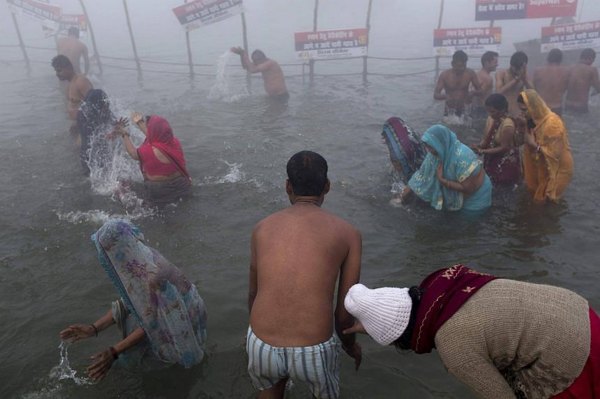 Indian devotees taking a holy dip at Sangam for a holy dip during the annual Magh Mela festival in Allahabad, on Jan 14, 2018.