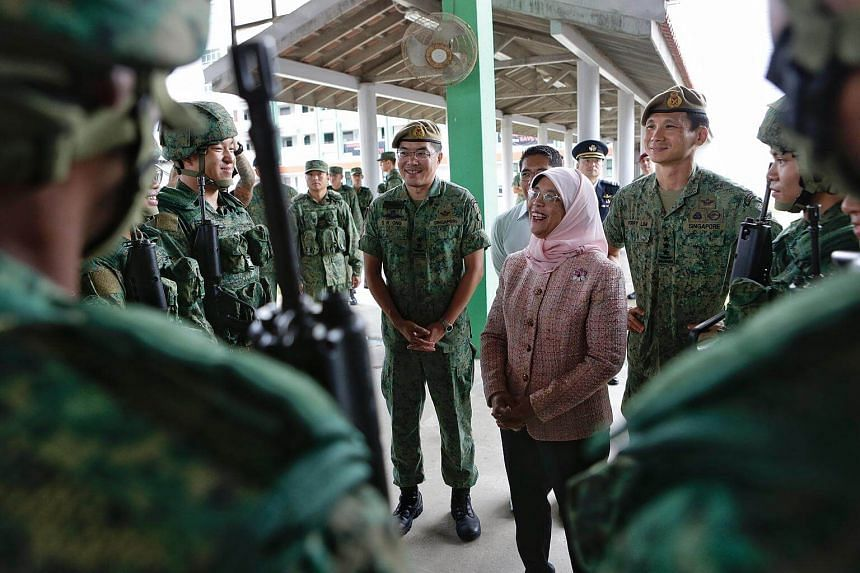 President Halimah Yacob interacts with recruits who underwent SAR21 Technical Handling Training during her first visit to an SAF unit at the Basic Military Training Centre on Pulau Tekong on Jan 23, 2018.