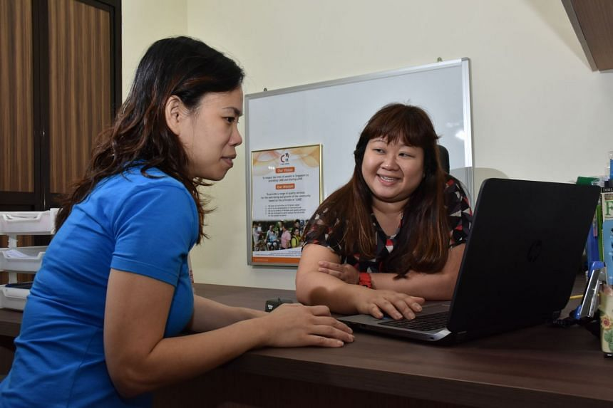 ETS programme head and senior educational therapist Joanne Sim (right) regularly updates parents such as Madam Lim (left) of their child's progress. PHOTO: NCSS