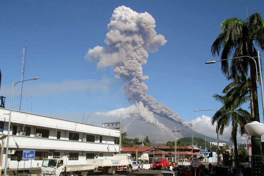 Smoke and ash rising high into the sky over Legazpi city, Albay province, after a new eruption on Jan 23, 2018.