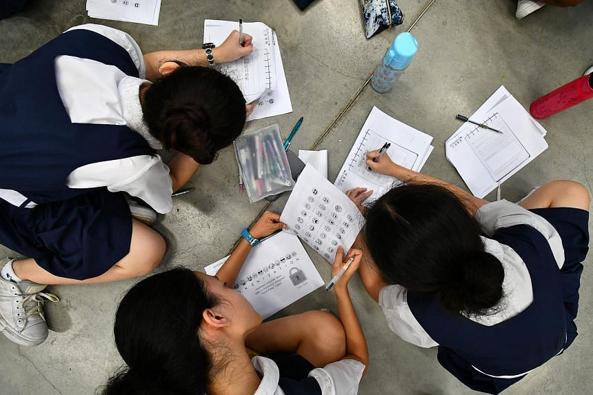 PLMGS students writing coded messages as part of a Girls4Tech programme, which aims to get girls interested in STEM fields, on Oct 23, 2017.