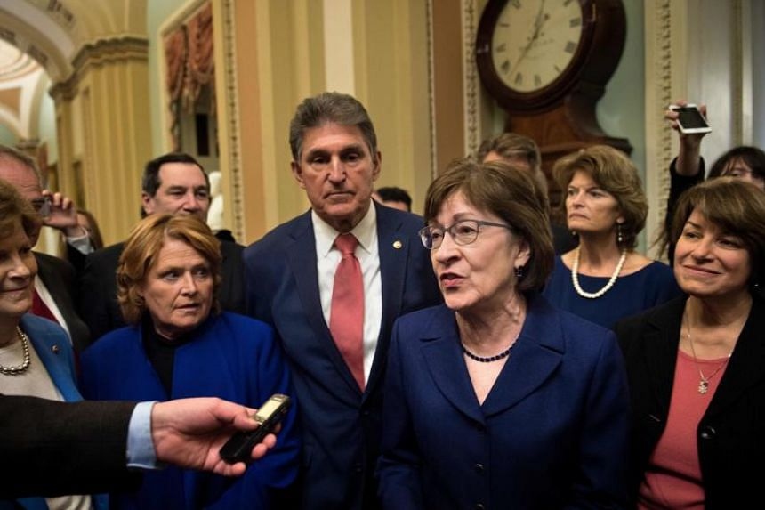 Senator Susan M. Collins speaks to reporters with Democratic and Republican Senators on Capitol Hill after the Senate moved to end a government shutdown on Jan 22, 2018 in Washington, DC.