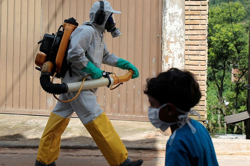 Fumigation being carried out during a campaign against yellow fever in Sao Paulo, Brazil.