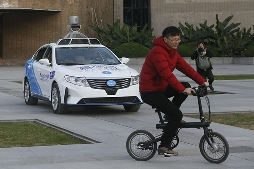 A self-driving car demonstrates how it can steer clear of a cyclist in Xi'an, capital of Shaanxi province, in December 2017.