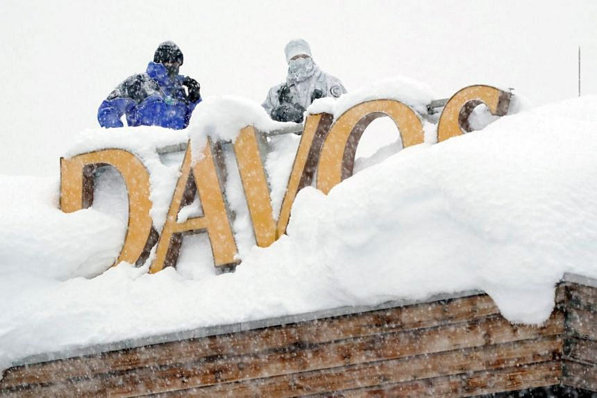 Snipers hold their position on the roof of a hotel during the World Economic Forum annual meeting in the Swiss Alps resort of Davos, Switzerland, on Jan 22, 2018.