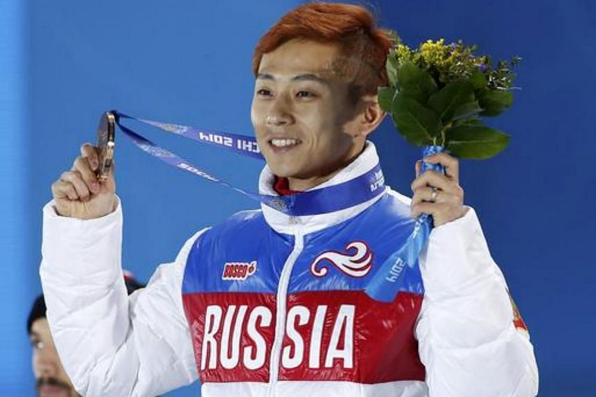 Victor Ahn of Russia holds up his bronze medal after competing in the men's 1,500 metres short track speed skating race at the Sochi 2014 Winter Olympics on Feb 10, 2014.