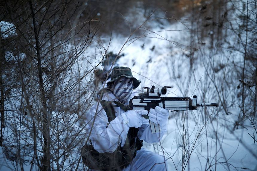 South Korean and US Marines take part in a winter military drill in Pyeongchang on Dec 19, 2017.