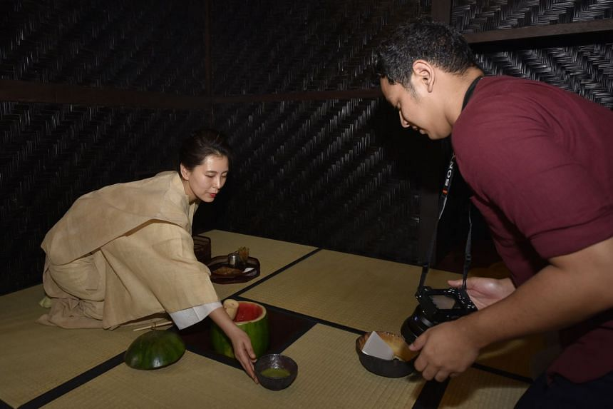 """Mai Ueda performing a tea ceremony inside the art installation named """"Untitled 2018"""", on the roof of the National Gallery Singapore, on Jan 23, 2018."""