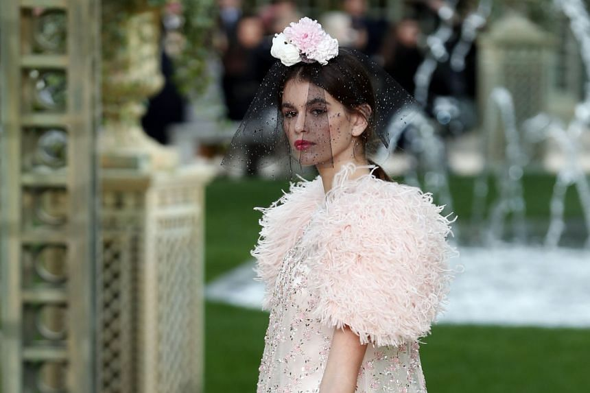 US model Kaia Gerber presents a creation from the Chanel Spring/Summer 2018 Haute Couture collection.