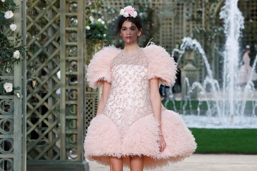 Model Kaia Gerber presents a creation for the Chanel Haute Couture Spring-Summer 2018 collection.