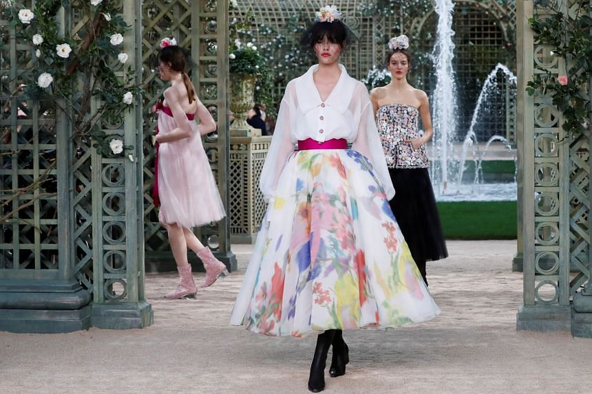 A model presents a creation for the Chanel Haute Couture Spring-Summer 2018 fashion collection.