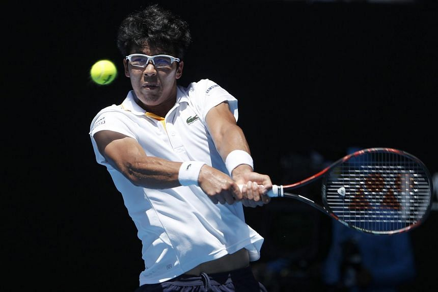 South Korea's Chung Hyeon hits a shot against American Tennys Sandgren during their quarterfinal match at the Australian Open at Rod Laver Arena, Melbourne, Australia, on Jan 24, 2018.