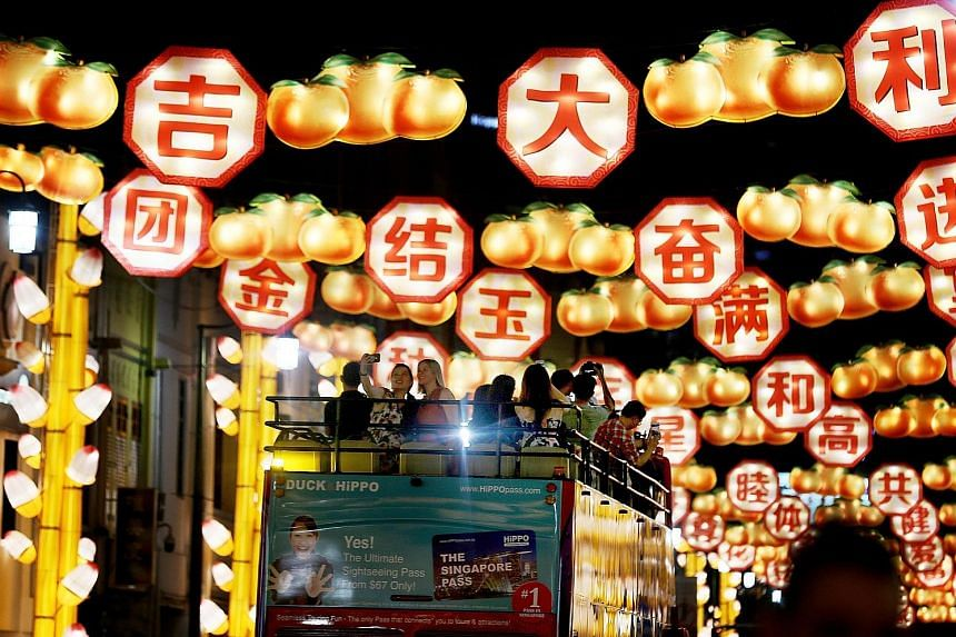 The annual festive light-up, which will kick off this year's Chinatown celebrations for Chinese New Year, features 2,188 handcrafted lanterns, of which 88 depict dogs to mark the Year of the Dog. The lanterns were designed in collaboration with the S
