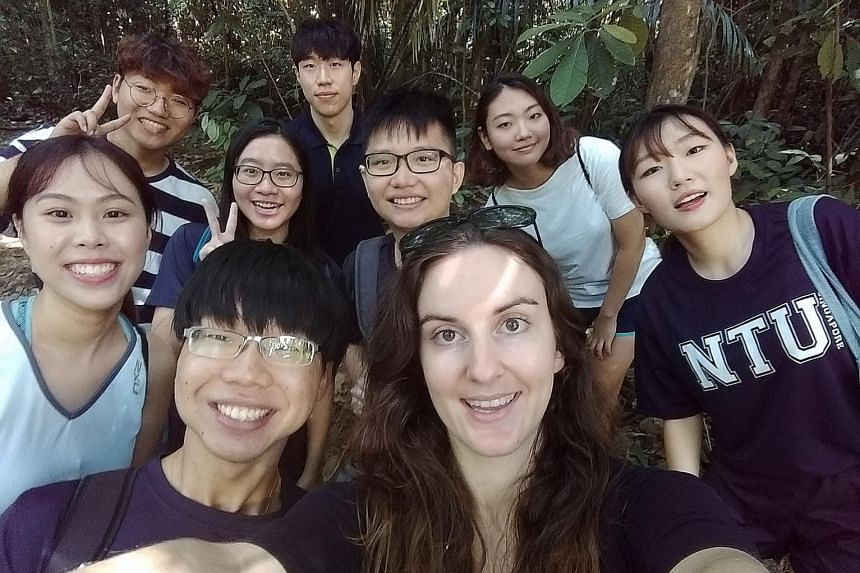 Canadian Michelle Christine and some of the about 100 people who met her in Singapore. She leaves with great memories of the country.