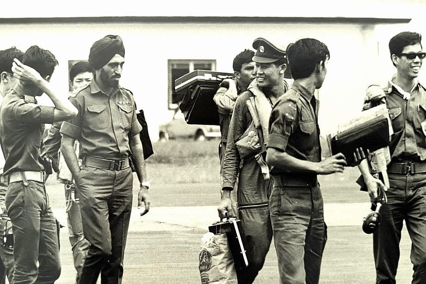 LT Leo Tin Boon (third from right), then a 21-year-old helicopter pilot, back in Singapore with the rest of the Kuantan detachment in 1971. It was the RSAF's - then the Singapore Air Defence Command - first humanitarian assistance and disaster relief