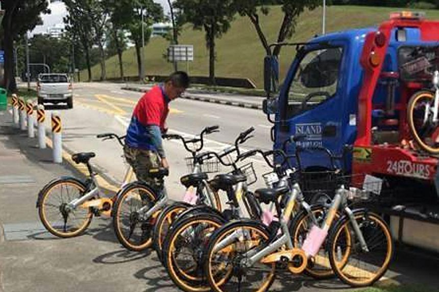"The bicycles impounded in the week-long operation this month belonged to oBike (left), Mobike and ofo (right). ""These bicycles were found to be causing inconvenience or obstructing footpaths,"" said the LTA."