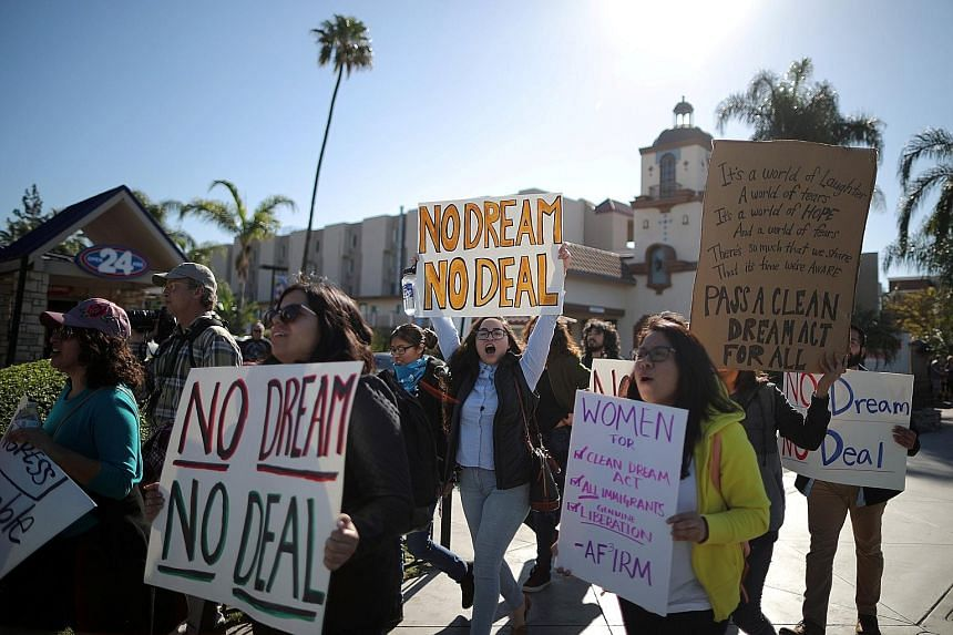 Supporters of the Deferred Action for Childhood Arrivals programme demonstrating in California on Monday for a clean Dream Act that will protect undocumented immigrants who came to the US as children.