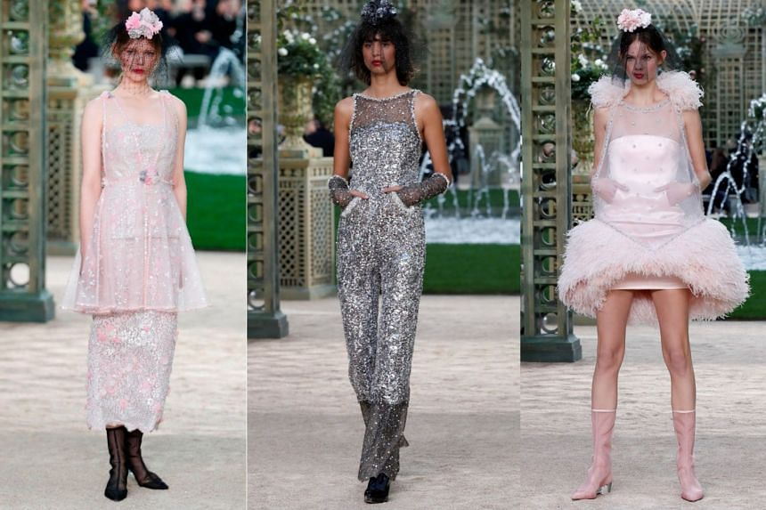 Models present creations from the Chanel Spring/Summer 2018 Haute Couture collection.