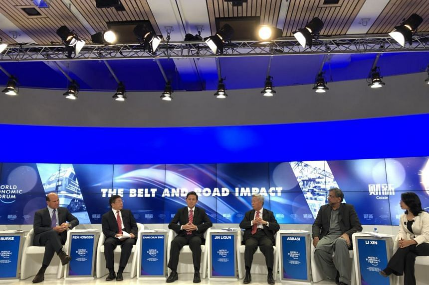 Minister in the Prime Minister's Office Chan Chun Sing (centre) speaking at a panel discussion, along with Pakistan PM Shahid Khaqan Abbasi (second from right), AIIB president Jin Liqun (third from right) and other business leaders.