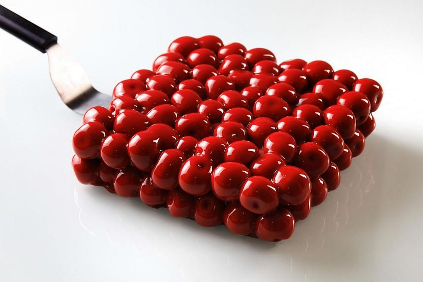 A cherry cake, made to look like red bubbles encased in a cube, from chef Dinara Kasko.
