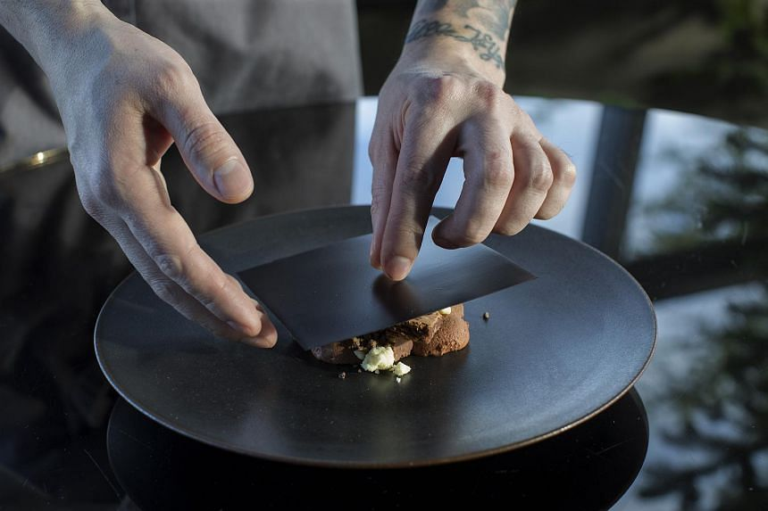 Pastry chef Baruch Ellsworth preparing his signature dessert, which includes elements like a tobacco-infused chocolate mousse and a Madagascar chocolate brownie, at Canlis, in Seattle, on Dec 22, 2017.