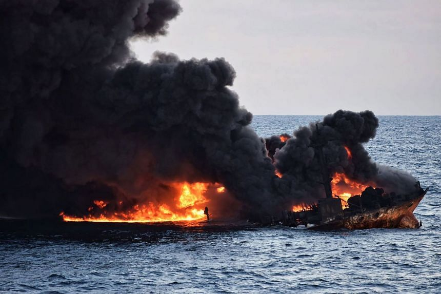 Smoke and flames rising from the stricken tanker Sanchi on Jan 14, 2018, after an accident with the freighter CF Crystal. Investigators opened the black boxes from both ships, on Jan 24, 2018.