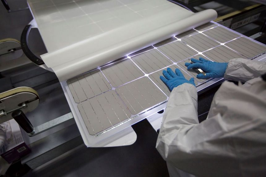 A production operator checking a panel at the SolarWorld solar panel factory in Hillsboro, Oregon, on Jan 15, 2018.
