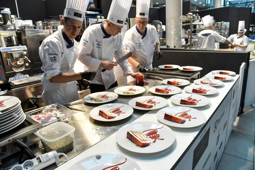 French artisans preparing their dishes during the 8th Gelato World Cup in Rimini, Italy, on Jan 20, 2018.