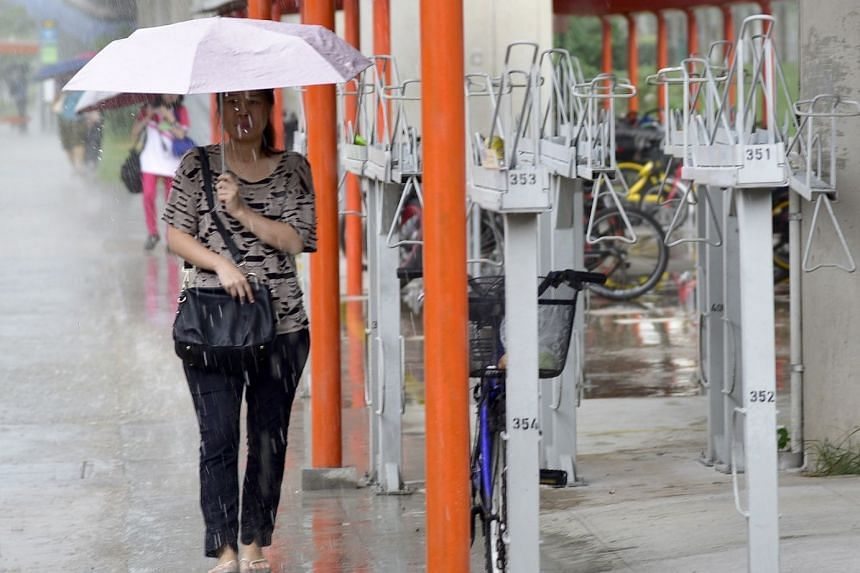 People outside Yishun MRT station on Jan 20, 2018. The National Environment Agency said that heavy rain is expected over many areas in Singapore on Jan 24 from 5.15pm to 6.15pm.