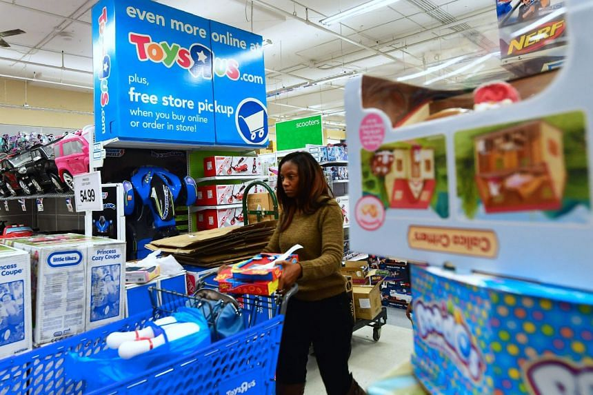 A woman shops at a Toys 'R' Us store in Alhambra, California, on Dec 19, 2017.