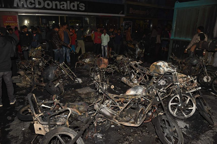 Several hundred people attacked shops in malls and set alight 50 motorbikes and damaged more than 150 cars across the city.