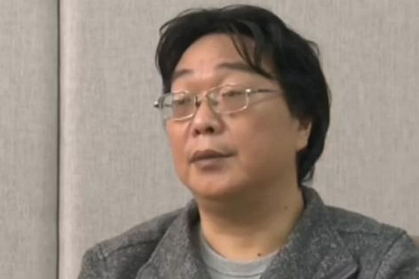 This screengrab taken from Chinese state broadcaster CCTV footage in Beijing shows Gui Minhai speaking in an interview broadcast, on Jan 17, 2016.