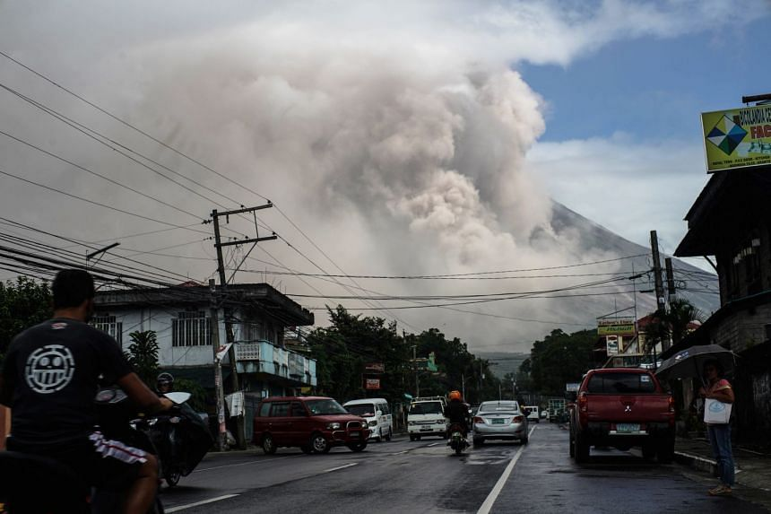 Mount Mayon shot up a giant mushroom-shaped cloud as it continues to erupt near Camalig town, on Jan 22, 2018.