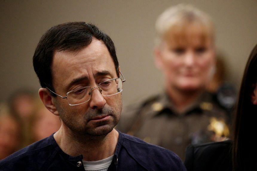 Nassar stands during his sentencing hearing in Lansing, Michigan.