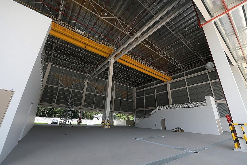 Another military green building is a boat shed at the RSN's Changi Naval Base that is powered by renewable energy from the sun. ME4 Dave Singh and DSTA principal architect Aw Boon Seong at the RSAF's green hangar at Paya Lebar Air Base.