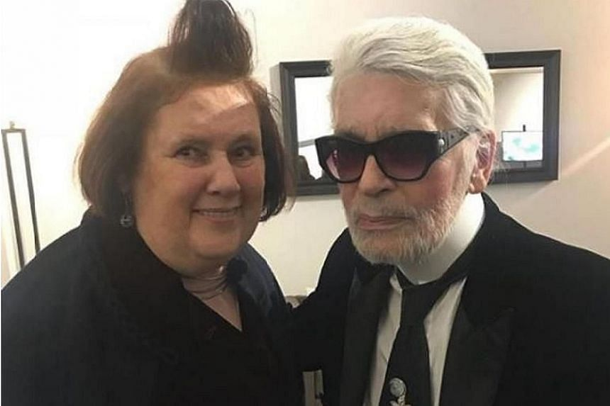 Karl Lagerfeld (with Vogue critic Suzy Menkes) sports a radical new look, his first change in almost 20 years.