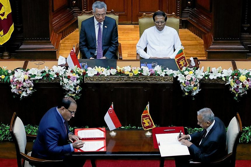 Dr Saman Kelegama, Sri Lanka's chief negotiator, died of a heart attack last June, casting a cloud of uncertainty over the future of the FTA negotiations. Singapore's Minister for Trade and Industry (Industry) S. Iswaran (far left) signs the bilatera