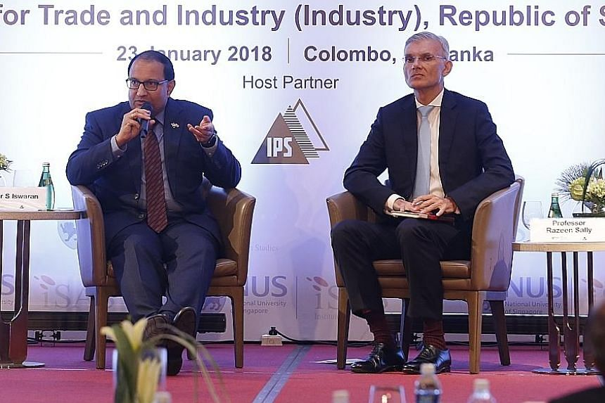 Minister for Trade and Industry (Industry) S. Iswaran speaking at the ISAS Colombo Colloquium 2018, with moderator Razeen Sally, chairman of the Institute of Policy Studies of Sri Lanka and senior adviser to the Sri Lankan Finance Ministry.