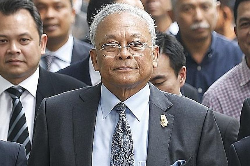 Suthep Thaugsuban and members of his political activist group arriving at the Criminal Court in Bangkok yesterday.