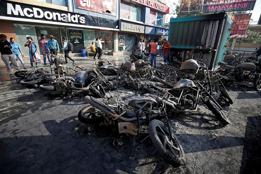 Burnt motorbikes outside a multiplex in Ahmedabad yesterday. Protesters went on the rampage in the Gujarat city ahead of the planned release of Bollywood movie Padmaavat today.