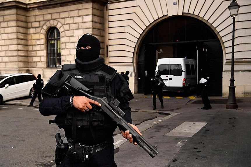 French police standing guard as a van carrying Bendaoud arrives at a courthouse in Paris yesterday.