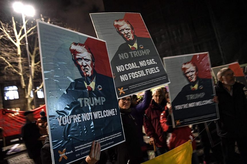 Activists protesting in Zurich on Tuesday against the attendance of US President Donald Trump at the World Economic Forum in Davos, Switzerland.