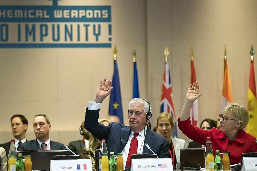 US Secretary of State Rex Tillerson and Swedish Foreign Minister Margot Wallstrom acknowledge resolutions during a meeting on the international partnership against impunity for the use of chemical weapons.