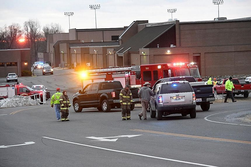 Police investigators at the scene of the shooting at Marshall County High School. The 15-year-old suspect killed two people and injured 12 other students before a sheriff's deputy managed to stop and apprehend the boy who was armed with a handgun.
