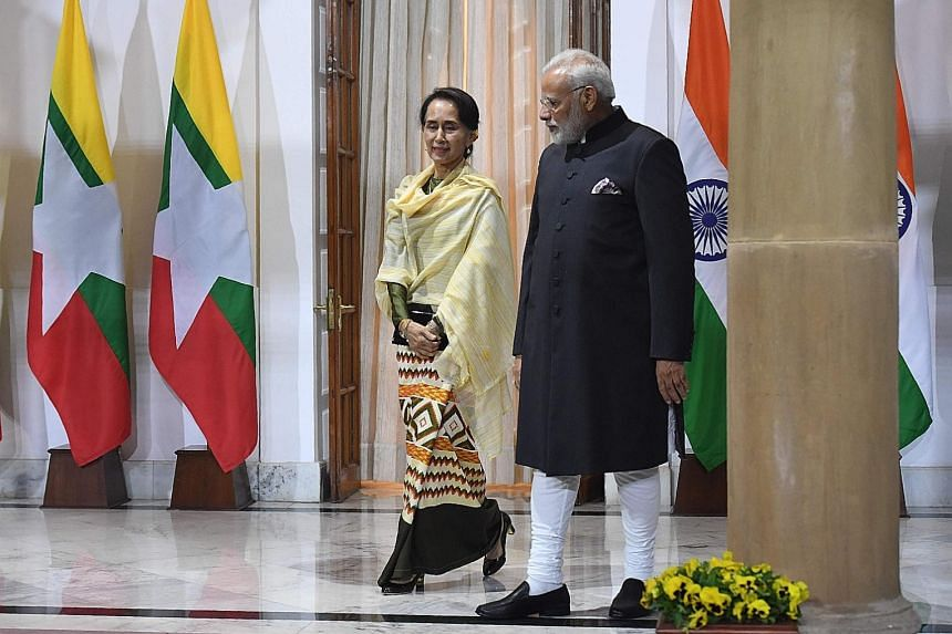 Indian Prime Minister Narendra Modi welcoming Myanmar's civilian leader, Ms Aung San Suu Kyi, yesterday, ahead of a meeting on the sidelines of the Asean-India Commemorative Summit in New Delhi.