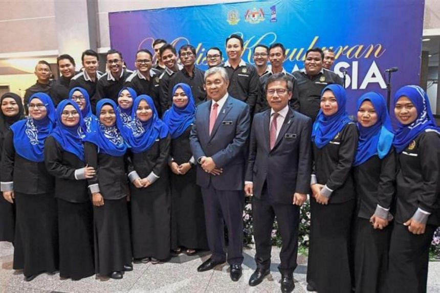 Malaysia's Deputy Prime Minister Datuk Seri Dr Ahmad Zahid Hamidi with People's Volunteer Corps members at an event hosted by the organisation.