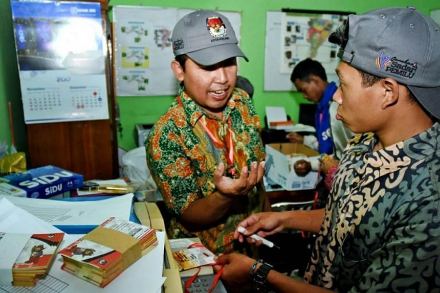 Election officials check the distribution of election tools during the 2018 Simultaneous Regional Elections Checking and Verification program at Kasin Village office in Malang, East Java, Indonesia.